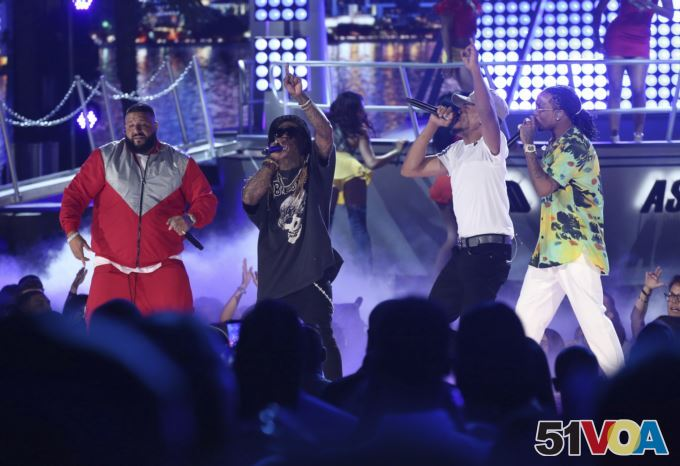 DJ Khaled, from left, Lil Wayne, Chance The Rapper, and Quavo perform