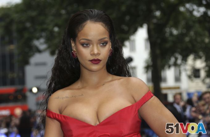 Rihanna poses for photographers as she arrives for the European film premiere of 'Valerian and the City of a Thousand Planets' in London, July 24, 2017.
