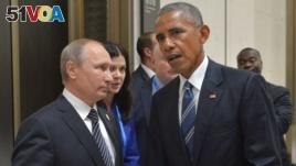 Russian President Vladimir Putin, left, listens to U.S. President Barack Obama in Hangzhou in eastern China's Zhejiang province, Monday, Sept. 5, 2016. (Alexei Druzhinin/Sputnik, Kremlin Pool Photo via AP)