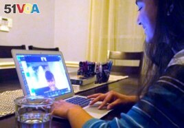 FILE - Charvi Goyal, 17, gives an online math tutoring session on Jan. 4, 2021, in Plano, Texas.