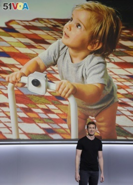 Google's Juston Payne talks about the Google Clips camera at a Google event at the SFJAZZ Center in San Francisco, Wednesday, Oct. 4, 2017. (AP Photo/Jeff Chiu)