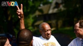 Bill Cosby flashes a