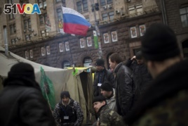A Russian flag waves on a tent set by anti-Yanukovych protesters in Kiev's Independence Square, the epicenter of the country's current unrest, Ukraine, Saturday, March 1, 2014.