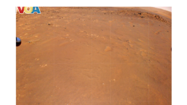 NASA's Ingenuity Mars Helicopter took this color image during its fourth flight, on April 30, 2021.