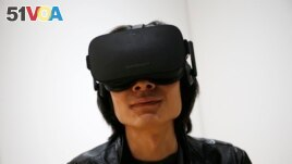 In this file photo, Peijun Guo wears the Oculus Rift VR headset at the Oculus booth at CES International in Las Vegas, Jan. 6, 2016. (AP)