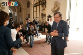 Italian theoretical physicist Giorgio Parisi speaks to journalists as he arrives at the Accademia dei Lincei , Tuesday, Oct. 5, 2021. (AP Photo/Domenico Stinellis)