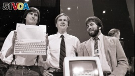 In this April 24, 1984, file photo, Steve Jobs, left, chairman of Apple Computers, John Sculley, center, president and CEO, and Steve Wozniak, co-founder of Apple, unveil the new Apple II computer in San Francisco. (AP Photo/Sal Veder)