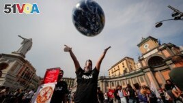 In this Thursday, July 22, 2021 file photo, people demonstrate on the sidelines of a G20 environment meeting, in Naples, Italy. (AP Photo/Salvatore Laporta, File)