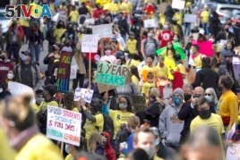 In this March 13, 2021, file photo, parents, students, teachers and supporters march during a rally for San Francisco public schools to reopen during the coronavirus pandemic in San Francisco. (AP Photo/Jeff Chiu, File)
