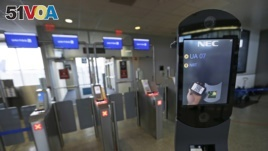A U.S. Customs and Border Protection facial recognition device is shown at a United Airlines gate, Wednesday, July 12, 2017, at George Bush Intercontinental Airport, in Houston. (AP Photo/David J. Phillip)