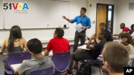In this 2013 file photo, Ivan Silverberg teaches his American Studies class to eighth and ninth graders at the Niles North High School in Skokie, Illinois.  (AP Photo/Scott Eisen)