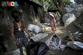 In this Sept. 26, 2019 file photo, Indian rag-pickers collect plastic bottles in New Delhi, India. India is launching an ambitious campaign to eliminate single-use plastics within three years.