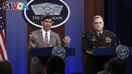 Defense Secretary Mark Esper, left, speaks as Chairman of the Joint Chiefs of Staff Army Gen. Mark Milley, right, listens during a briefing at the Pentagon in Washington, Monday, March 2, 2020. (AP Photo/Susan Walsh)