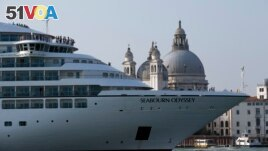 In this Sept. 27, 2014 file photo a cruise ship transits in the Giudecca canal in front of St. Mark's Square, in Venice, Italy. (AP Photo/Andrew Medichini)
