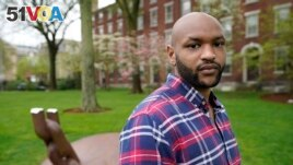 Brown University graduate Jason Carroll, stands for a portrait on the Brown campus in Providence, R.I., on Tuesday, May 4, 2021, near the Slavery Memorial. (AP Photo/Steven Senne)