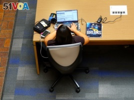 A student studies in the James West Alumni Center at the University of California, Los Angeles.