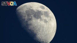 A photo taken on May 13, 2019 shows a view of the moon in Cannes, southern France. - The Moon is steadily shrinking, causing wrinkling on its surface and quakes, according to an analysis of imagery captured by NASA's Lunar Reconnaissance Orbiter . (AFP)