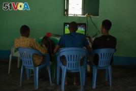 Former Al Shabab members watch a football match at a rehabilitation center for former militants in Baidoa, Somalia, Sept. 17, 2016. (Photo: J. Patinkin/VOA)