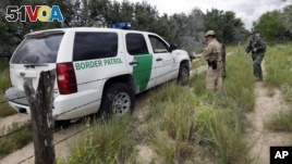 n this Sept. 5, 2014 photo, a U.S. Customs and Border Protection Air and Marine agents and U.S. Customs and Border Protection agents compare notes as they patrol near the Texas-Mexico border, near McAllen, Texas. (AP Photo/Eric Gay)