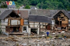 FILE - This Thursday, July 15, 2021 file photo shows destroyed houses in Schuld, Germany