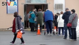 People wait in line to receive Pfizer's coronavirus disease (COVID-19) vaccine at a pop-up community vaccination center at the Gateway World Christian Center in Valley Stream, New York, U.S., February 23, 2021.