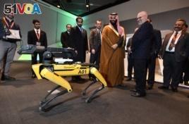 Saudi Crown Prince Mohammed bin Salman visits a demonstration of technology, including a robotic