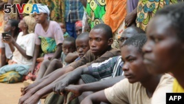 A group of Burundian refugees waits for a soap and blanket distribution at Gashora on Bugesera, Rwanda, April 10, 2015. Some refugee children have allegedly been recruited to fight against Burundi.