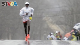 FILE - Geoffrey Kirui, of Kenya, separates himself from the pack in the men's elite division of the 122nd Boston Marathon on Monday, April 16, 2018, in Newton, Mass. (AP Photo/Steven Senne)