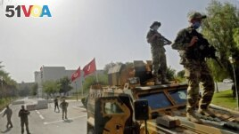 Tunisian military forces guard the area around the parliament building in the capital Tunis on July 26, 2021, following protests in reaction to a move by the president last night to suspend the north African country's parliament and dismiss the Prime Mini