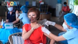 A woman receives a shot of the Moderna COVID-19 vaccine in Vung Tau, Vietnam, Monday, Sep. 13, 2021. (AP Photo/Hau Dinh)