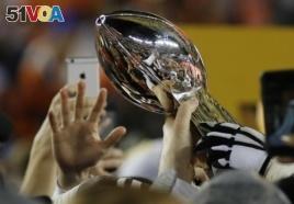Denver players celebrate winning the Super Bowl in February 2016.