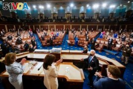 President Joe Biden arrives to address a joint session of Congress, Wednesday, April 28, 2021, in the House Chamber at the U.S. Capitol in Washington