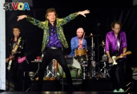 FILE - From left, Ron Wood, Mick Jagger, Charlie Watts and Keith Richards of the Rolling Stones perform in Pasadena, California, August 22, 2019.