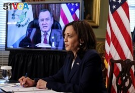 U.S. Vice President Kamala Harris takes notes as she speaks via videoconference with Guatemala's President Alejandro Giammattei to discuss solutions to an increase in migration as she looks for ways to defuse a migrant crisis at the U.S. border