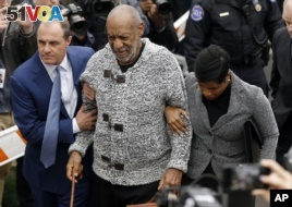 Bill Cosby arrives at court to face a felony charge, Wednesday, Dec. 30, 2015, in Elkins Park, Pa. Cosby was charged Wednesday with drugging and sexually assaulting a woman at his home 12 years ago. (AP Photo/Matt Rourke)