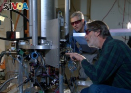 NIST physicists Steve Jefferts (front) and Tom Heavner with the NIST-F2