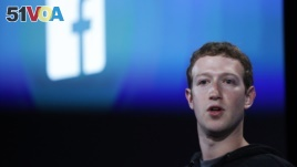 Mark Zuckerberg, Facebook's co-founder and chief executive introduces 'Home' a Facebook app suite that integrates with Android during a Facebook press event in Menlo Park, California, April 4, 2013. (REUTERS/Robert Galbraith)