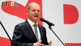 Olaf Scholz, top candidate for chancellor of the Social Democratic Party (SPD), speaks during a press conference at the party's headquarters in Berlin, Germany, Sept. 27, 2021. (AP Photo/Michael Sohn)