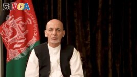 FILE PHOTO: Afghan President Ashraf Ghani makes an address about the latest developments in the country from exile in United Arab Emirates, in this screen grab obtained from a social media video on Aug. 18, 2021.