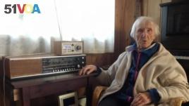In this photo taken on Sunday, Jan. 8, 2017, 98-year-old Judith Haaland sits next to her decades-old radio set in Stavanger, Norway.