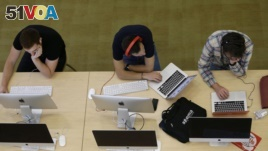 Students work on computers at the Hunt Library at North Carolina State University in Raleigh, N.C., on Tuesday, May 3, 2016. (AP Photo/Gerry Broome)