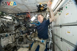 NASA astronaut Ricky Arnold does some filming on the International Space Station Oct. 3, 3018