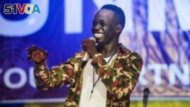 In this file photo, comedian Kuech Deng Atem performs during the