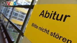 A sign at a German school announces the Abitur exam taken by German students at the end of their high school years. (Change.org)