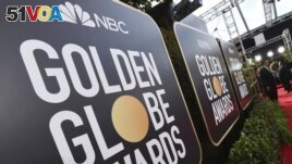 FILE - Signage promoting the 77th annual Golden Globe Awards and NBC appears in Beverly Hills, Calif. on Jan. 5, 2020. NBC said Monday that will not air the Golden Globes in 2022. (Photo by Jordan Strauss/Invision/AP, File)
