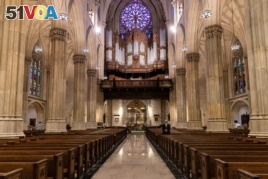 Empty seats are seen during an Easter service at St. Patrick's Cathedral as the outbreak of the coronavirus disease (COVID-19) continues in the Manhattan borough of New York City, New York, U.S., April 12, 2020. (REUTERS/Jeenah Moon)