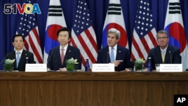 South Korean Foreign Minister Yun Byung-se, (left center) and Secretary of State John Kerry (right center) speak to reporters in Washington D.C.