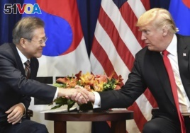 US President Donald Trump (R) looks on as South Korean President Moon Jae-in speaks during a bilateral meeting in New York on September 24, 2018, a day before the start of the General Debate of the 73rd session of the General Assembly. / AFP PHOTO.