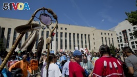 Native Americans gather during a rally outside U.S. District Court in Washington D.C. on Aug. 24, 2016, in solidarity with the Standing Rock Sioux tribe in the lawsuit against the Army Corps of Engineers.