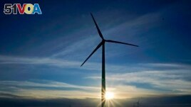 FILE - A wind turbine is pictured, Jan. 13, 2021, near Spearville, Kan. Recent studies contend that because of falling alternative energy prices, President Joe Biden's net-zero carbon goal can be accomplished more cheaply than once was thought.